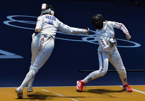 Chile's Caterin Bravo Aranguiz (L) fences against Great Britain's Corinna Lawrence during their Women's Epee fencing bout.