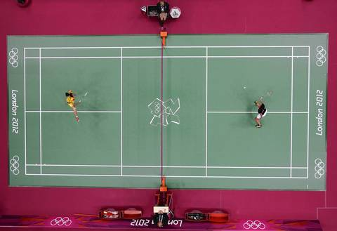 Yihan Wang of China, left, competes against Michele Li of Canada in their Women's Singles Group Badminton match on Day 3 of the London 2012 Olympic Games at Wembley Arena.
