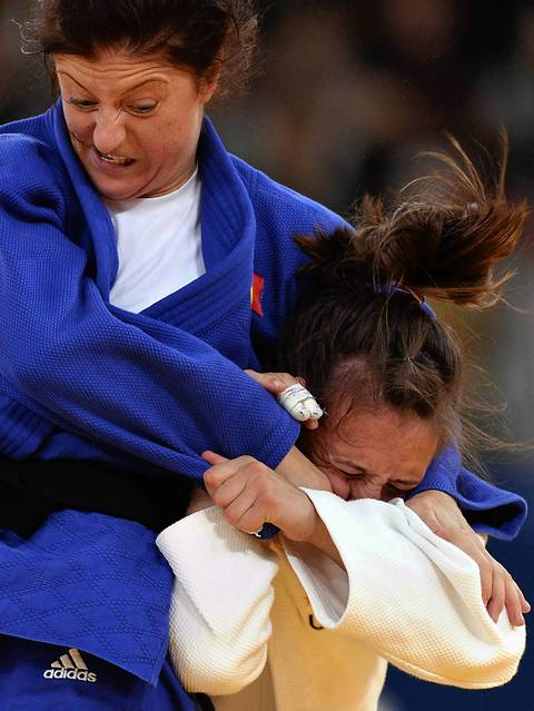 United States' Marti Malloy, right, competes with Romania's Corina Caprioriu during their women's -57kg judo contest match.