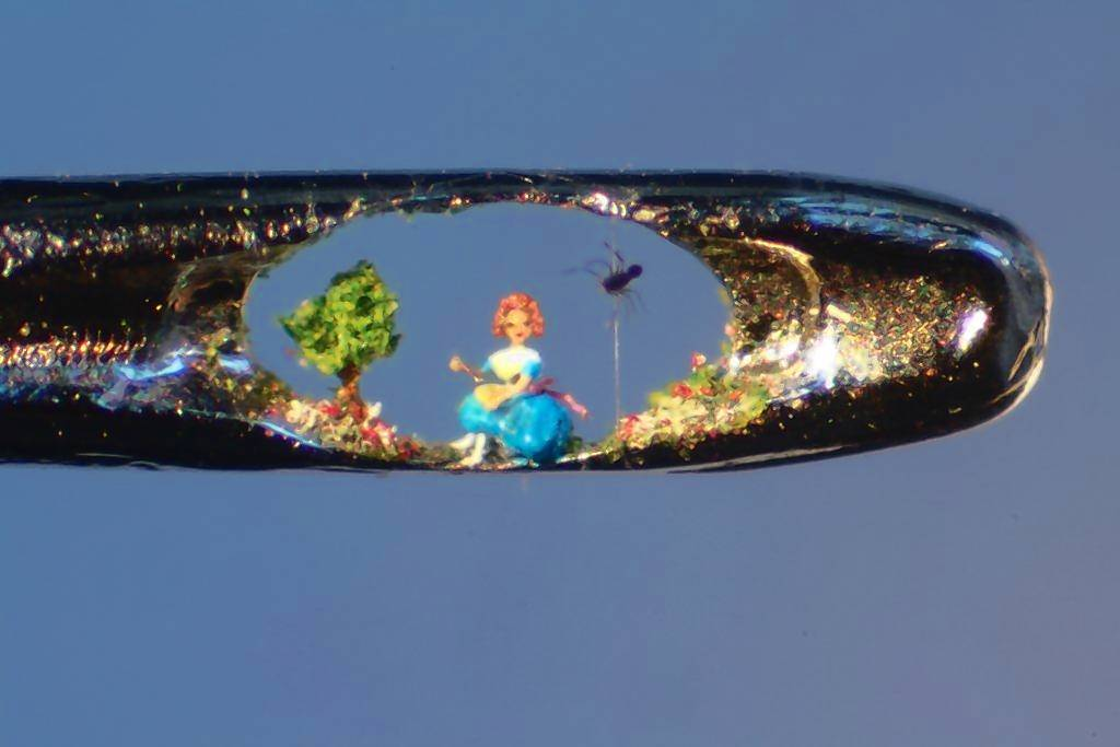 Little Miss Muffet (and spider) are featured in one of Willard Wigan's in-the-eye-of-a-needle sculptures.
