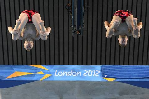 Russia's Iilya Zakharov and Victor Minibaev compete in the men's synchronized 10m platform final diving event at the Olympic Park in London.