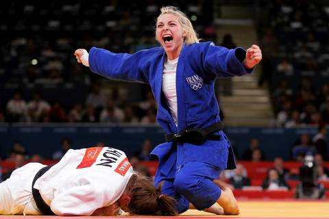 Automne Pavia of France celebrates her bronze medal B over Hedvig Karakas of Hungary during the Women's -57 kg Judo on Day 3 of the London 2012 Olympic Games.