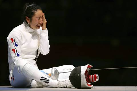 A Lam Shin of Korea crys after losing to Britta Heidemann of Germany in the Women's Epee Individual Fencing Semifinals on Day 3 of the London 2012 Olympic Games.