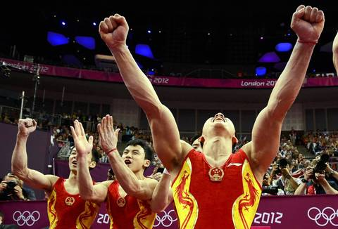 China's team celebrates after taking the gold medal in the men's gymnastics team final at the London 2012 Olympic Games. China won the gold four years ago in Beijing.