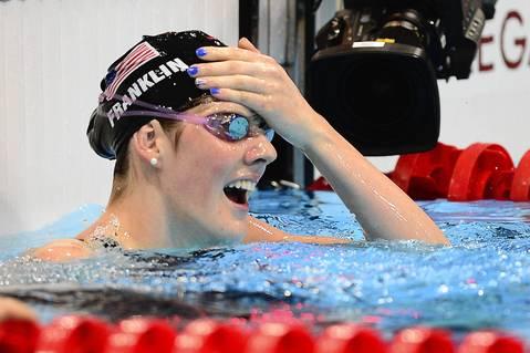 U.S. Olympic swimmer Missy Franklin celebrates winning gold in the women's 100m backstroke final swimming event.