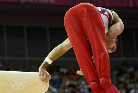 Danell Leyva of the U.S. falls from the pommel horse during the men's gymnastics team final in London