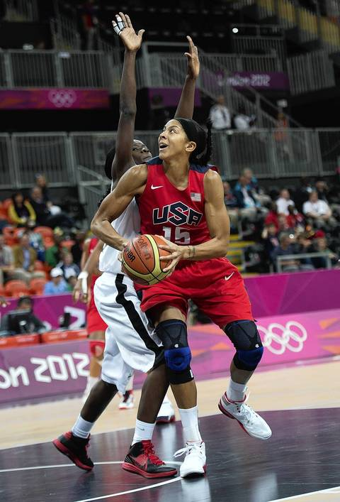 USA's Candace Parker (15) is defended by Angola's Luisa Tomas (11) during their game at the Basketball Arena at the Olympic Park during the 2012 Summer Olympic Games in London, England.
