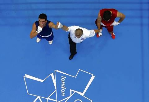 Nicaragua's Osmar Bravo Amador, left, reacts after he defeated Montenegro's Bosko Draskovic, right, in the men's Light Heavy (81kg) Round of 32 boxing match at ExCeL venue during the London 2012 Olympic Games.