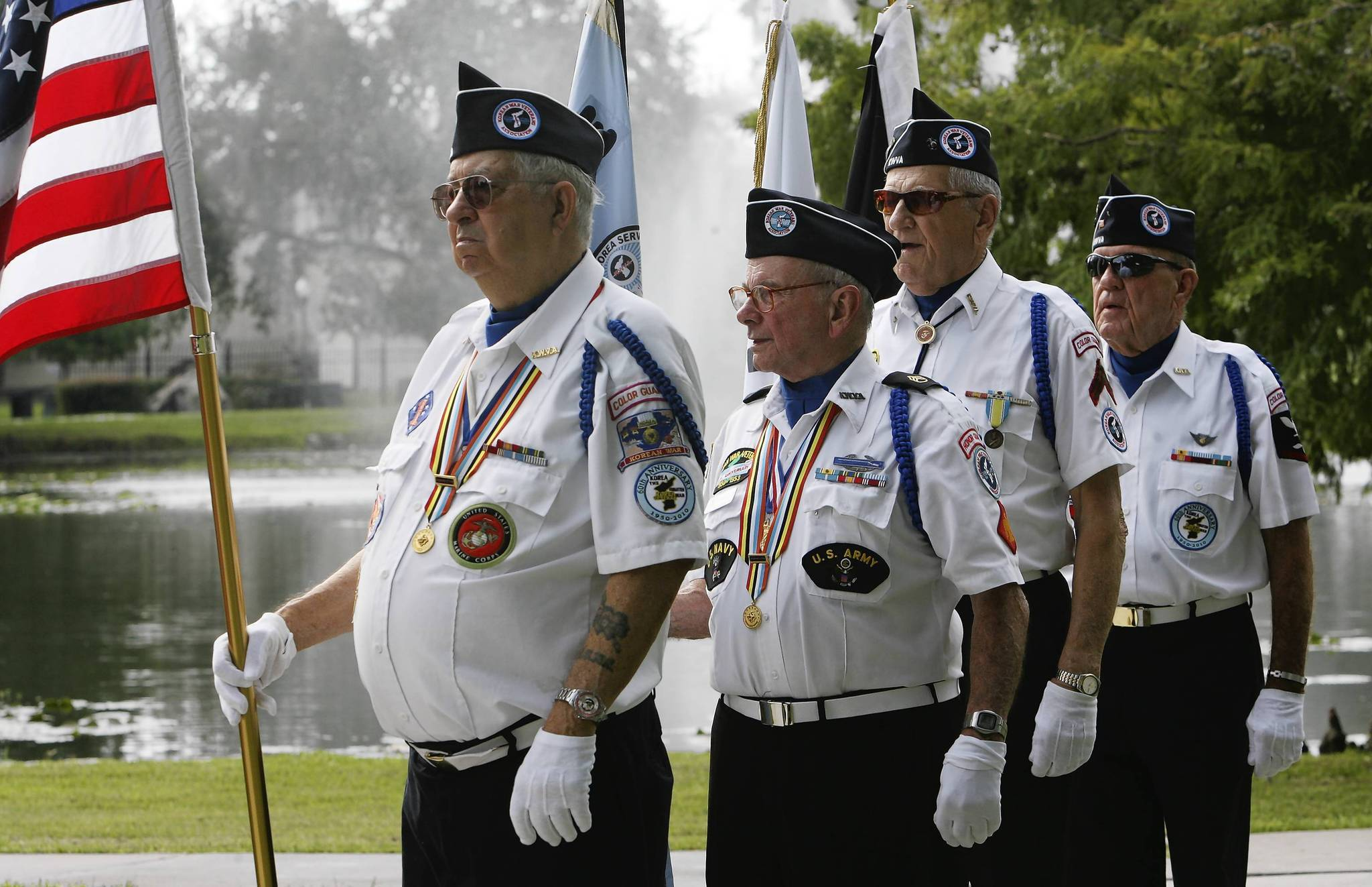 Members of the Color Guard from Korean War and Korean Service Veterans of lake County, post Colors at Veterans Memorial at Fountain Park in Leesbur, Fl. ,during a ceremony on  Friday, marking the 59th anniversary of the end of the Korean War when communist and United Nations representatives signed the cease-fire agreement at Panmunjom, ending three years of fighting. (Tom Benitez/Orlando Sentinel)