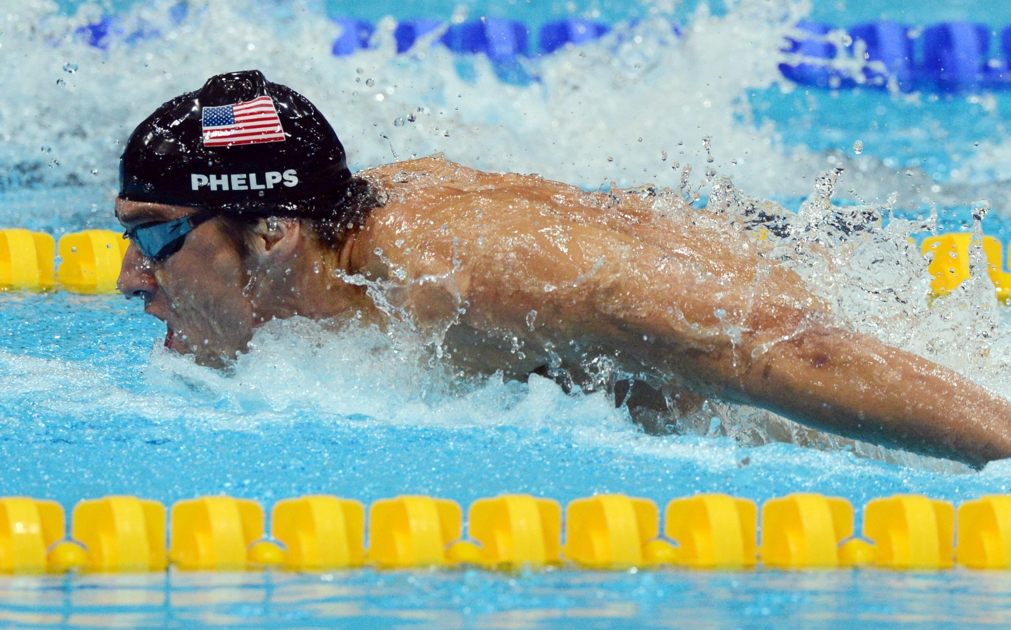 Michael Phelps swims the butterfly portion of the 4x100 medley relay Saturday.