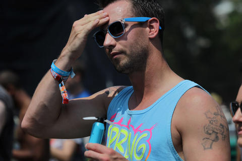 Bobby Findlay, 26, of Chicago wipes his forehead while watching LDJS perform at Lollapalooza Saturday August 4, 2012.