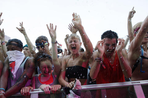 Members of the audience are sprayed with water while watching Salva perform at Lollapalooza Saturday August 4, 2012.