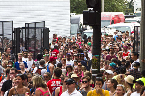 Fest goers exit Grant Park after Lollapalooza was temporarily stopped due to a severe weather warning.