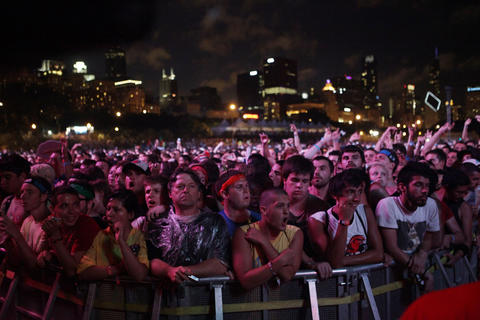Fans cheer as the Red Hot Chili Peppers perform at Lollapalooza Saturday August 4, 2012.