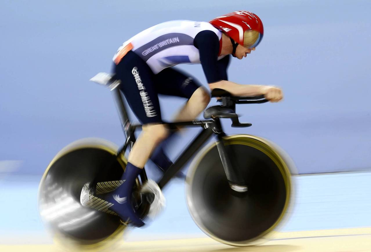 Britain's Edward Clancy competes in the track cycling men's omnium 4km individual pursuit at the Velodrome.