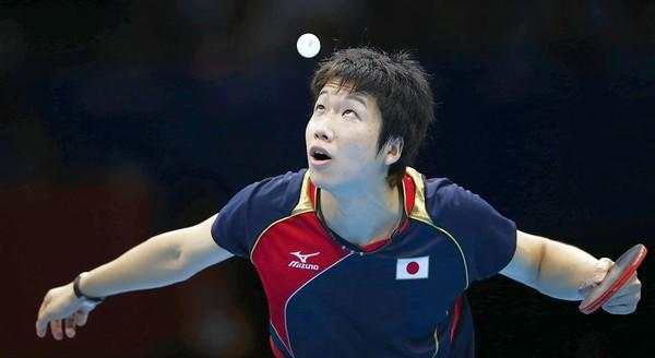 Japan's Jun Mizutani serves to Hong Kong's Jiang Tianyi in their men's team quarterfinals table tennis match at the ExCel venue.
