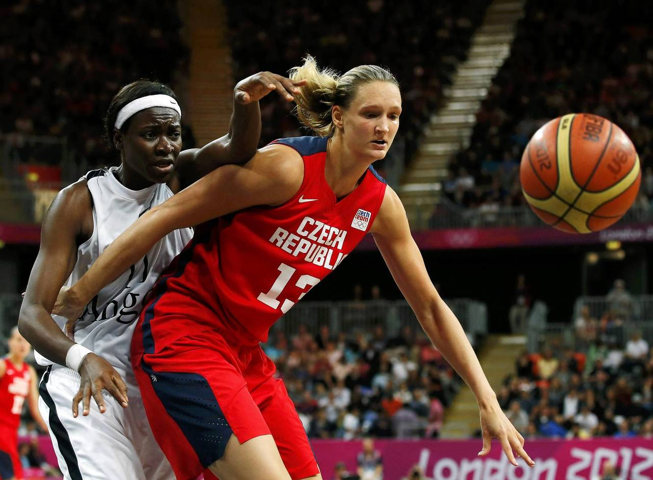 Angola's Luisa Tomas, left, fights for the ball with Czech Republic's Petra Kulichova during their women's preliminary round Group A basketball match at the Basketball Arena during the London 2012 Olympic Games.