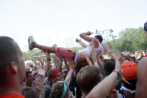 A members of the audience crowd surfs while watching Salva perform at Lollapalooza Saturday August 4, 2012.