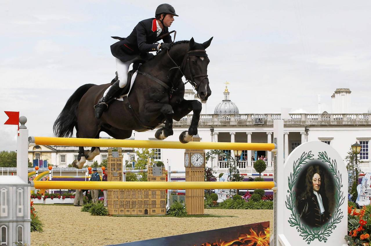 Britain's Ben Maher rides Tripple X during the equestrian individual jumping second qualifier at the London 2012 Olympic Games.