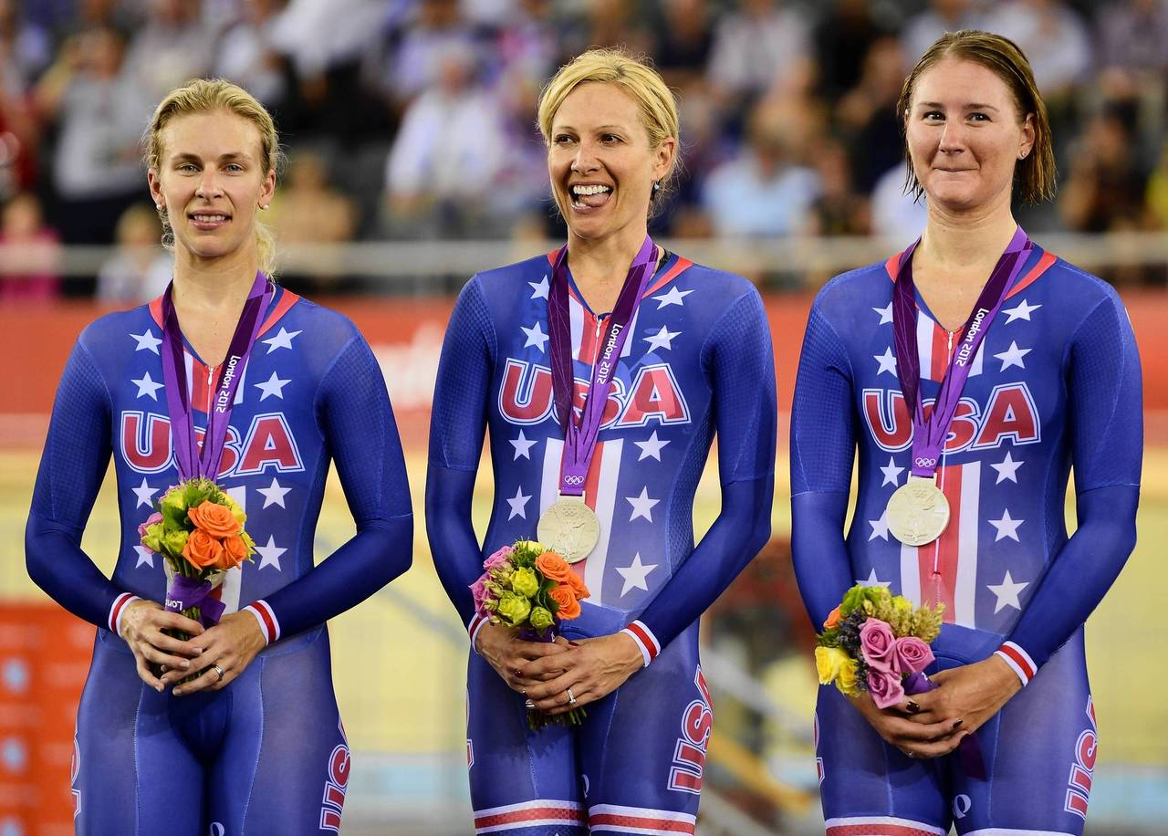 U.S. silver medalists Sarah Hammer, Dotsie Bausch and Lauren Tamayo stand on the podium for photos after their second place finish in the London 2012 Olympic Games women's team pursuit track cycling event at the Velodrome in the Olympic Park in East London.