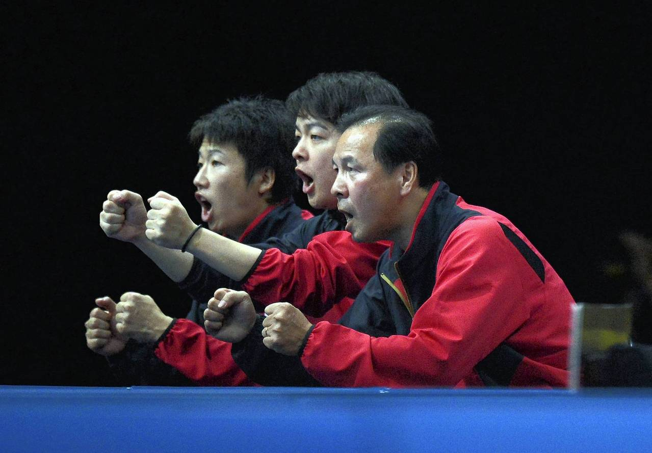 Japan's team celebrates a point for Koki Niwa against Hong Kong's Peng Tang during a table tennis men's team quarter-final match