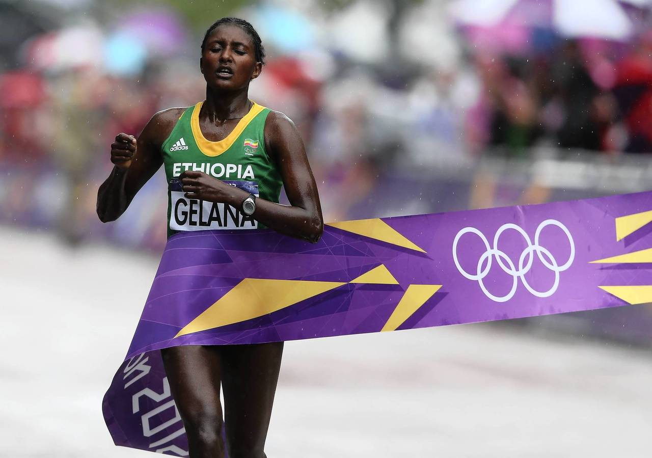 Tiki Gelana of Ethiopia crosses the finish line to win the gold medal in the Women's Marathon on Day 9 of the London 2012 Olympic Games.