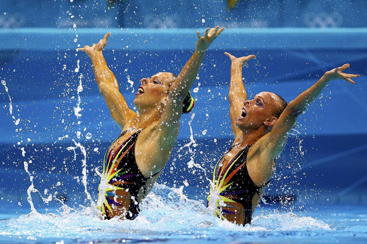 Plancarte Delgado and Nuria Diosdado of Mexico compete in the women's duets synchronized swimming technical routine.