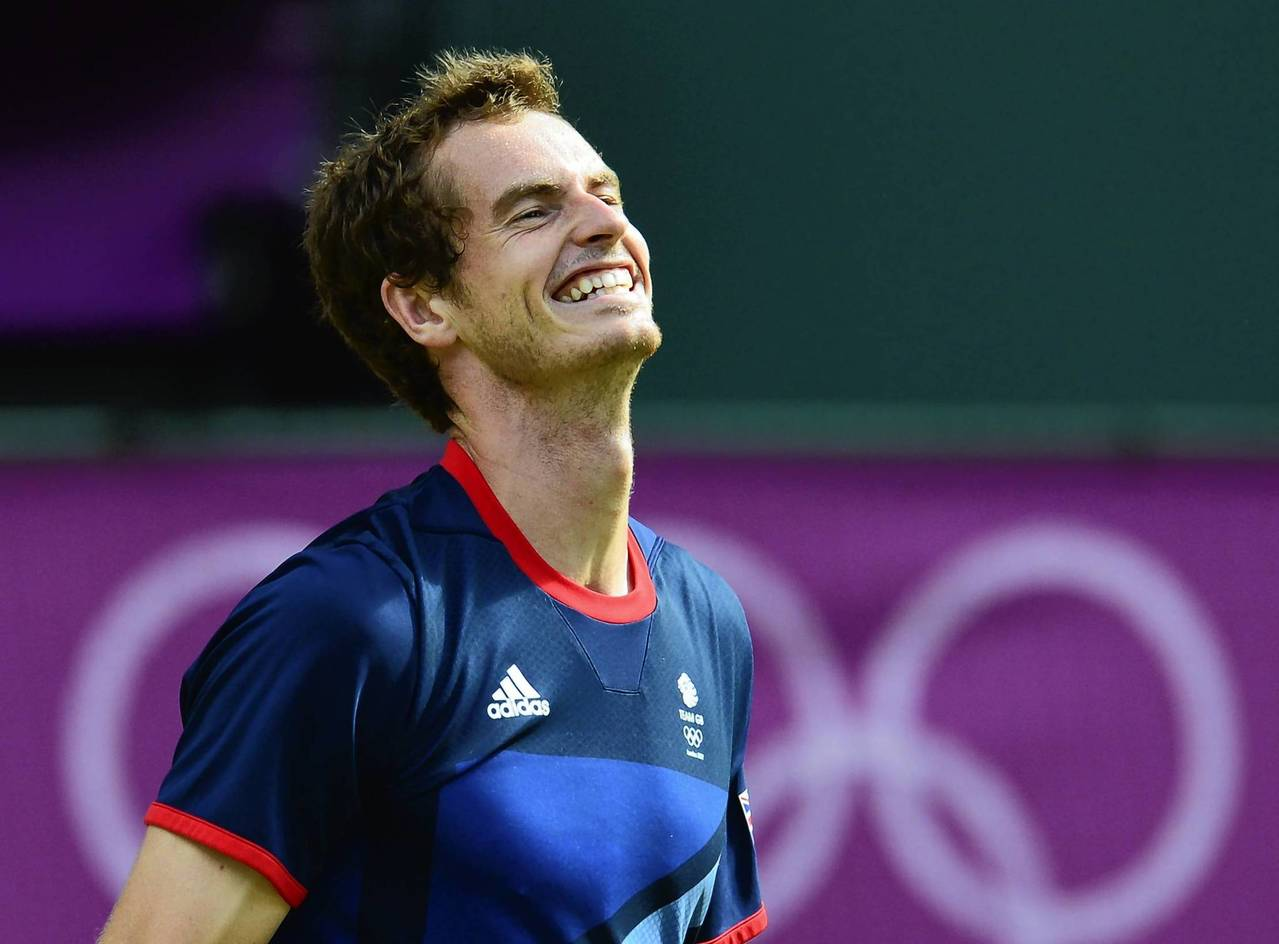 Great Britain's Andy Murray celebrates after winning the men's singles gold medal match.