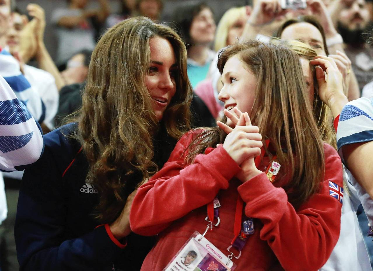 British gymnast Rebecca Tunney speaks to Catherine, Duchess of Cambridge as they watch the men's pommel horse competition in the North Greenwich Arena.