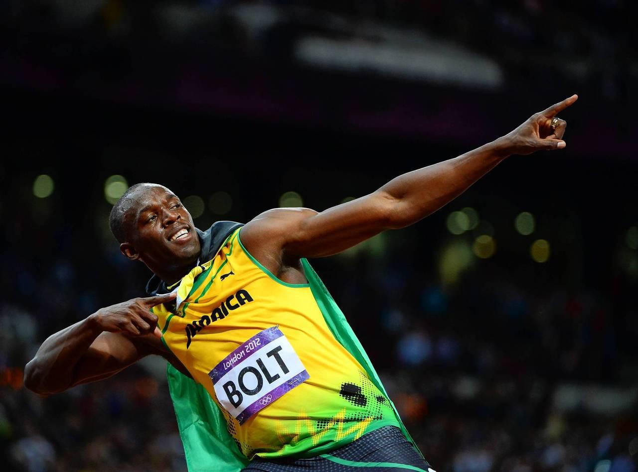 Jamaica's Usain Bolt celebrates after winning the men's 100m final.