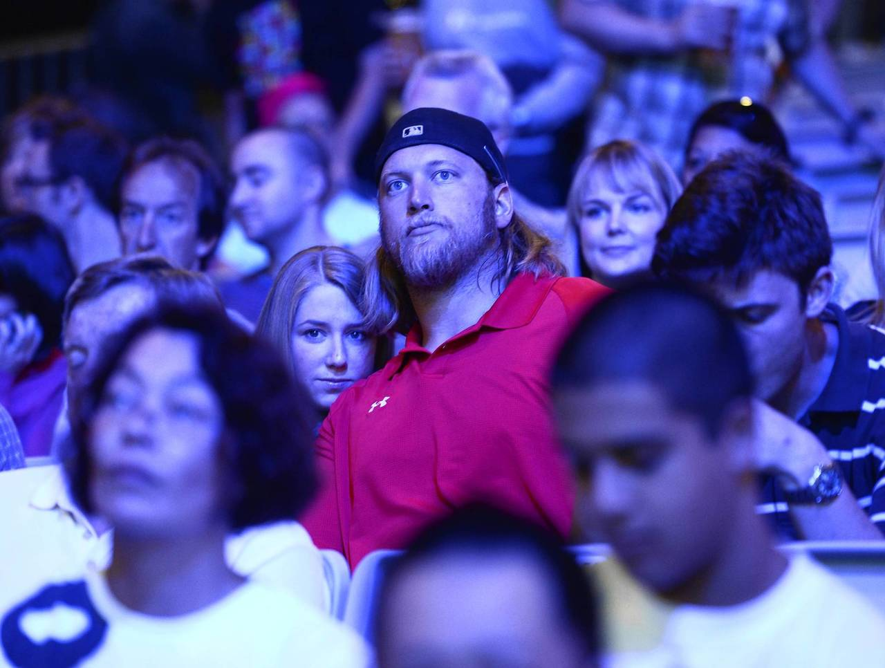 Nick Mangold of the Jets watches his sister Holly in the women's +75kg weightlifting at ExCeL - South Arena 3.