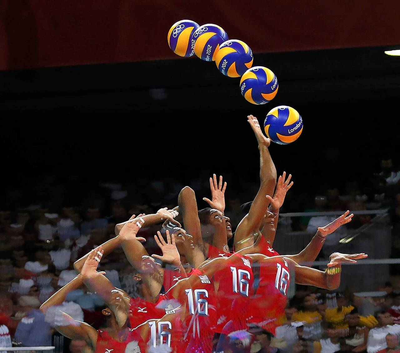 Foluke Akinradewo of the U.S. serves against Turkey during their women's group B volleyball match at Earls Court.