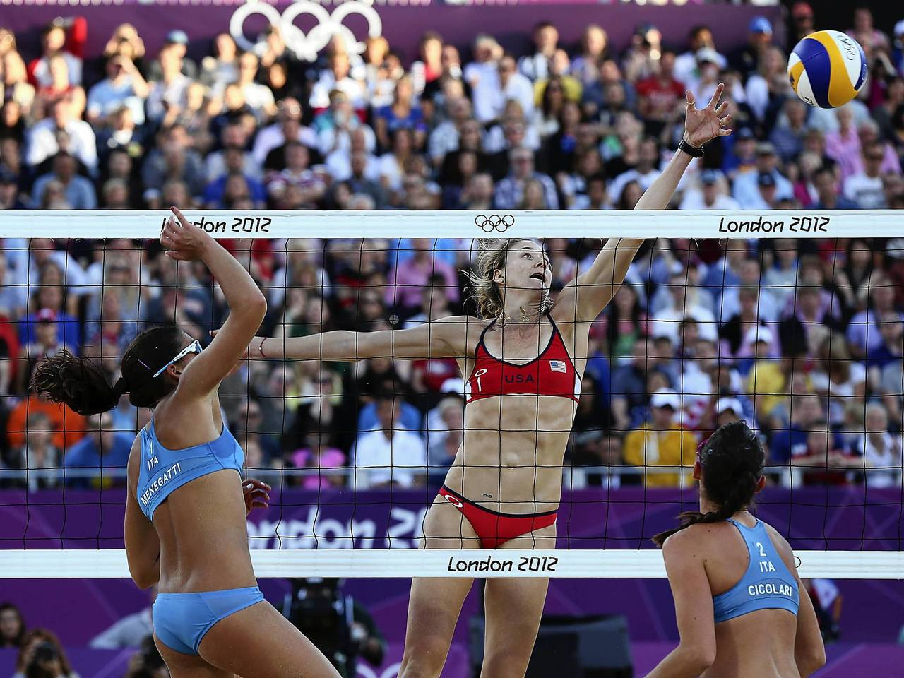 Kerry Jennings-Walsh stretches, but can't reach a spiked ball by Italy's Marta Menegatti, left, during the women's beach volleyball quarterfinal match.
