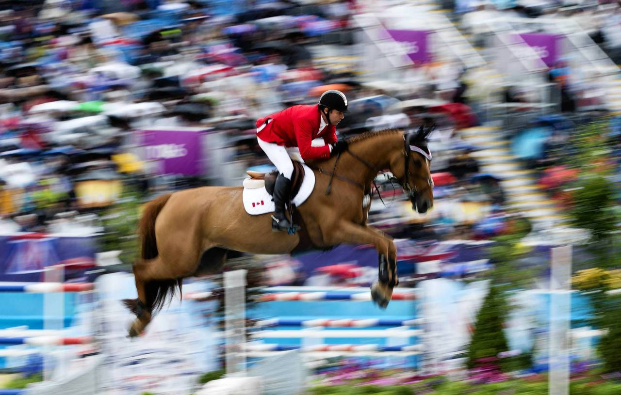 Canada's Eric Lamaze on Derly Chin de Muze competes in the second Individual Show Jumping qualifier.