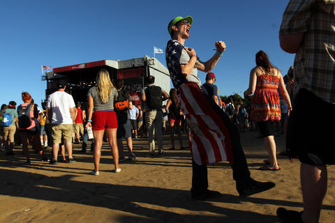 A festival-goer dances to At The Drive-In at Red Bull Stage at Lollapalooza in Grant Park in Chicago on Sunday, August 5, 2012.