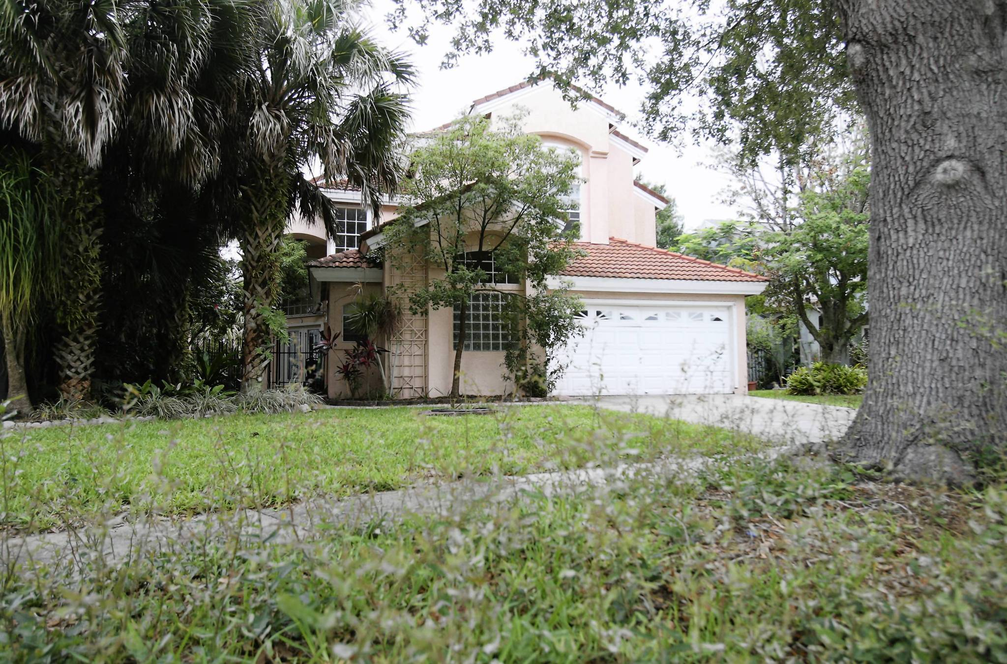 This house on Mystic Cove Drive in southeast Orlando was bought at public auction earlier this year. Photo taken on Friday, June 1, 2012. House was purchased in February by the top purchaser of local houses sold at public auction. A company called American Homes 4 Rent has purchased about 1,000 foreclosed houses in hard-hit states, including 150 houses at Orange Countys online foreclosure auctions since the start of the year  about 10 times more than any other buyers.. (Tom Benitez/Orlando Sentinel)