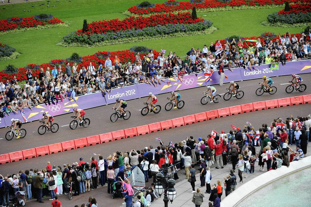 Competitors ride in the cycling leg of the Men's Triathlon event at the London 2012 Olympic Games.