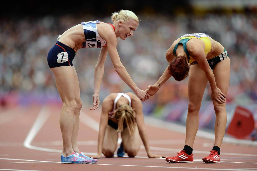 Barbara Parker (GBR) and Eloise Wellings (AUS) finish one of the Women's 5000m heats during the London 2012 Olympic Games at Olympic Stadium.
