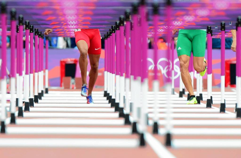 U.S. hurdler Aries Merritt, left, and Hungary's Daniel Kiss compete in one of the Men's 110m Hurdles heats at the London 2012 Olympic Games.