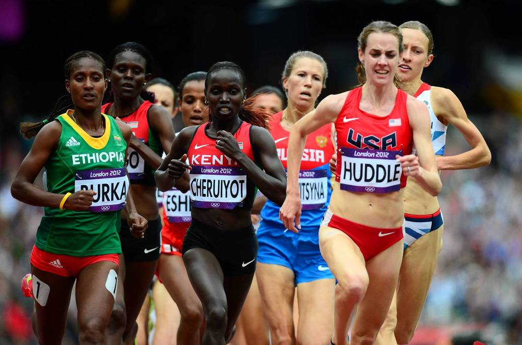 Ethiopia's Gelete Burka, Kenya's Vivian Jepkemoi Cheruiyot and U.S. runner Molly Huddle compete in the Women's 5000m heats at the London 2012 Olympic Games