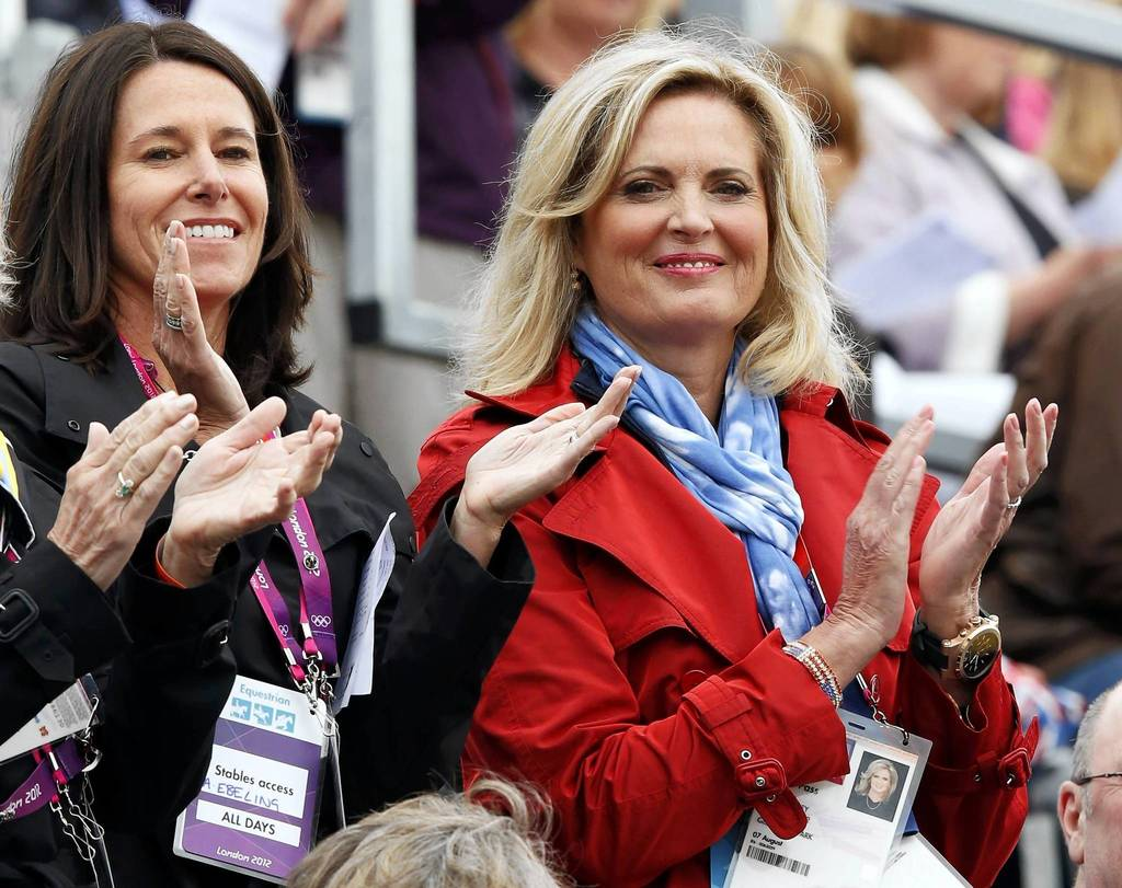 Ann Romney, right, wife of U.S. Republican presidential candidate Mitt Romney, applauds as her horse Rafalca, ridden by Jan Ebeling, competes in the Equestrian Dressage individual grand prix special at the London 2012 Olympic Games in Greenwich Park