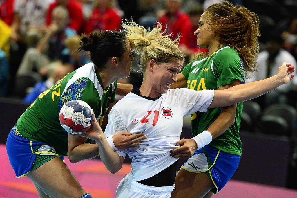 Norway's Goril Snorroeggen, center, vies with Brazilian players during the Women's quarterfinal handball match between Brazil and Norway at the London 2012 Olympics Games.