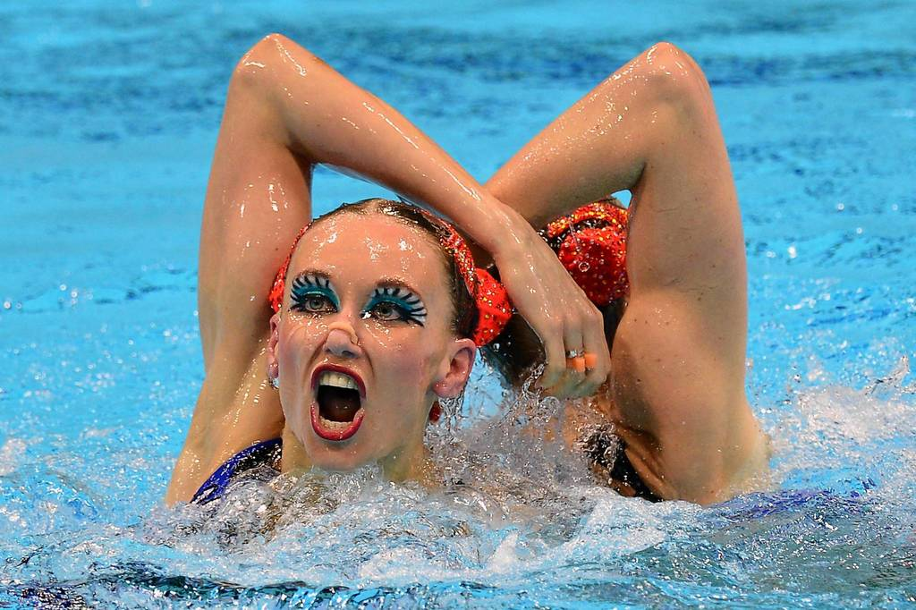 Russia's Natalia Ishchenko and Svetlana Romashina compete in the Duets Free Routine final during the synchronized swimming competition