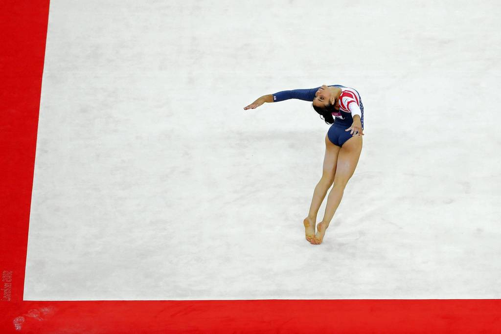 Alexandra Raisman competes in the floor exercise final on Day 11 at North Greenwich Arena.
