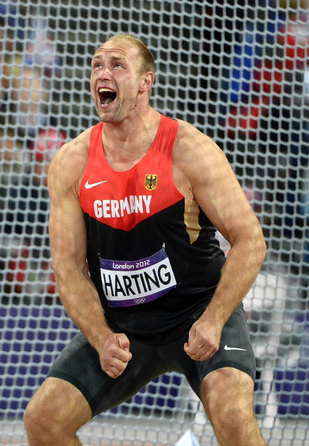 Germany's Robert Harting reacts in the men's discus throw final.
