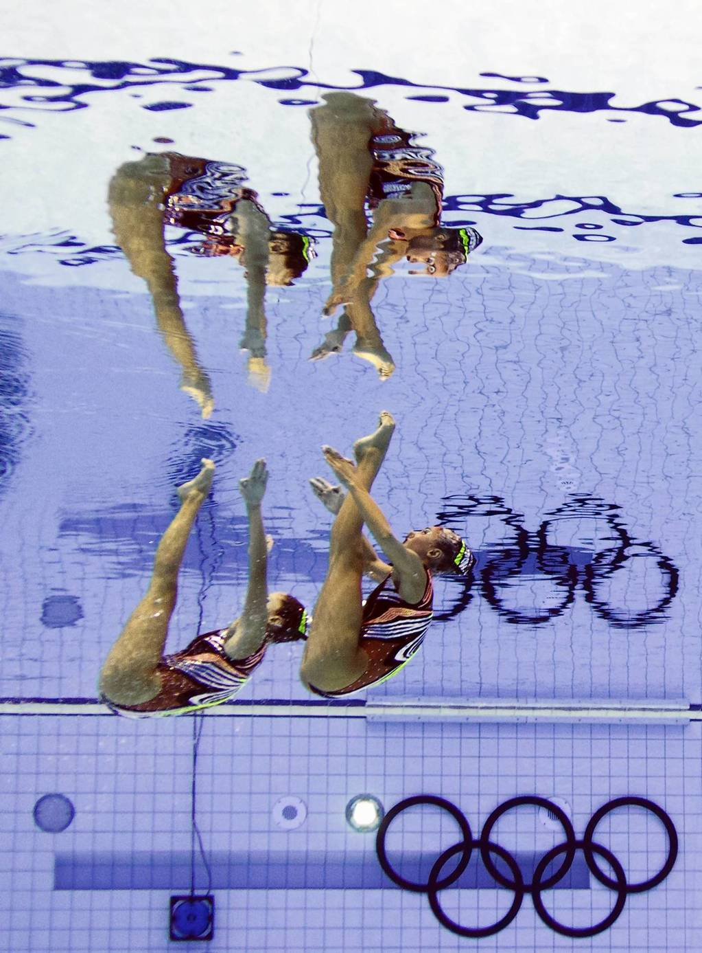 Greece's Evangelia Platanioti and Despoina Solomou compete in the duets free routine final during the synchronized swimming competition.