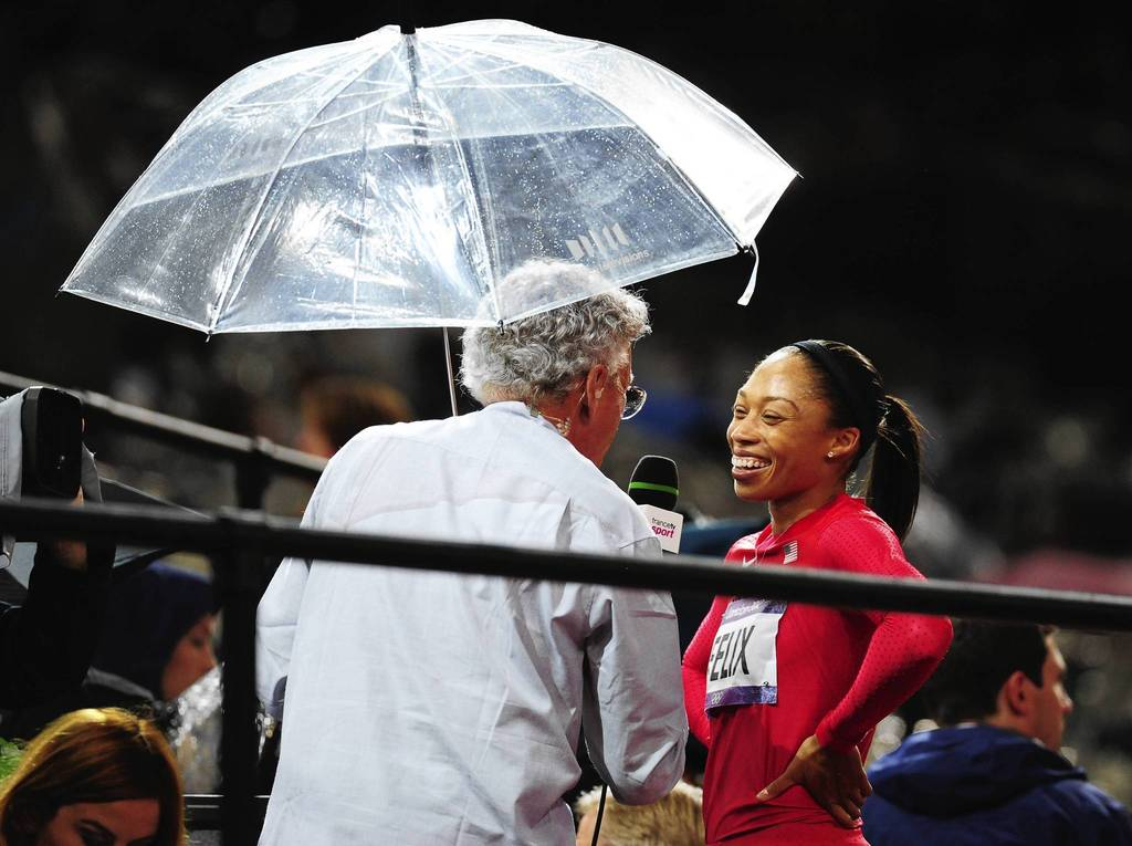 U.S. sprinter Allyson Felix talks with the media a after the 200m semifinals.