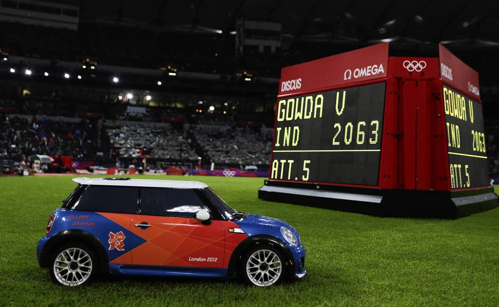 A remote control mini car returns a discus during the men's competition at Olympic Stadium.