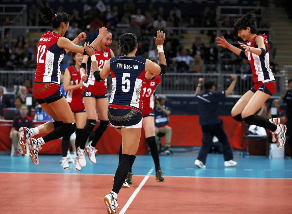 South Korea's players celebrate defeating Italy during their quarterfinal volleyball match at Earls Court.