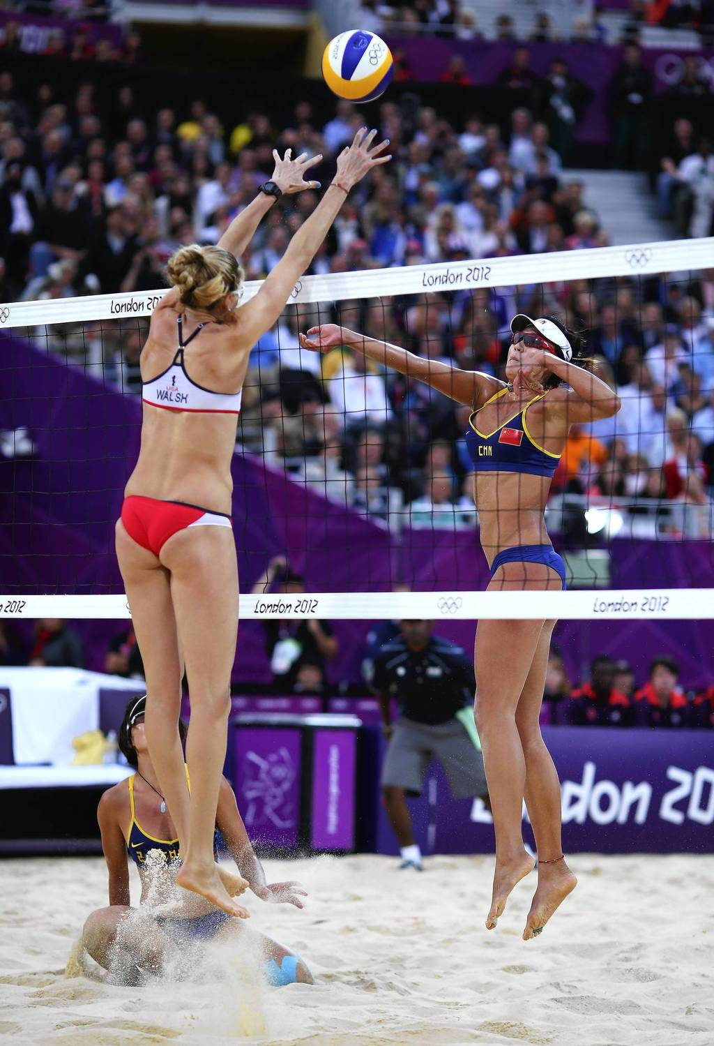 China's Chen Xue is blocked by Kerri Walsh-Jennings during a beach volleyball semifinal match.